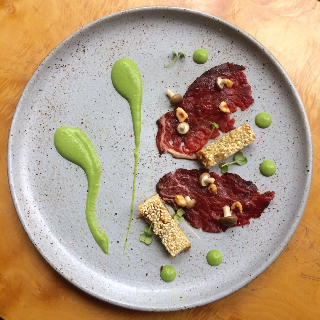 Cocoa Cured beef,sesame toast, green pea emulsion,coffee oil(2)
